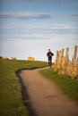 Young man on her evening jog along the seacoast Royalty Free Stock Photography