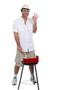 Young man and his barbecue Royalty Free Stock Photo