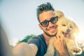 Young man and his dog taking a selfie Royalty Free Stock Photo