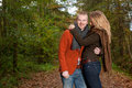 Young man and his nice girlfriend happy couple is having a time in october Royalty Free Stock Image