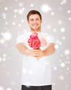 Young man holding bouquet of flowers Royalty Free Stock Photos