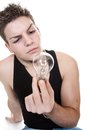 Young man holding bulb isolated ojn white Royalty Free Stock Image