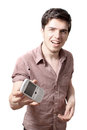 Young man holding cellphone Stock Photography