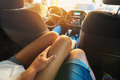 Young man holding his hand on the leg tanned young girl sitting in the back seat of the car Royalty Free Stock Photo
