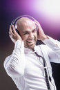 Young man holding his headphone and having fun with music Stock Image