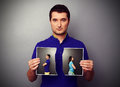 Young man holding the lacerated photo serious men of couple in quarrel Royalty Free Stock Photo