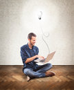 Young man holding a laptop concept idea Royalty Free Stock Photos