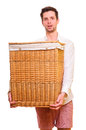 Young man holding a large flasket Royalty Free Stock Photo