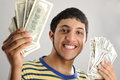 Young man holding money Stock Image