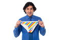 Young man holding multicolored underwear whose is that confused Royalty Free Stock Photo