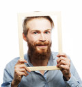 Young man holding picture frame Royalty Free Stock Photo