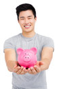 Young man holding a piggy bank Royalty Free Stock Photo