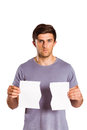 Young man holding ripped paper Royalty Free Stock Photo