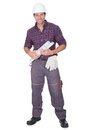 Young Man Holding A Roll Of Blueprints Royalty Free Stock Photo