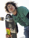 Young man holding skateboard low angle view of Stock Photos