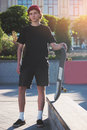 Young man holding skateboard. Royalty Free Stock Photo