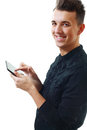 Young Man Holding a Touch Pad Royalty Free Stock Images