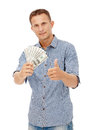 A young man holding a wad of cash up in his fist against white background Stock Image