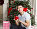 Young Man with Holiday Gift Stock Image