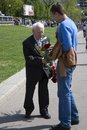 Young man honoring military victory day celebration in moscow may Royalty Free Stock Image