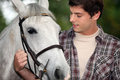 Young man with a horse Royalty Free Stock Photo