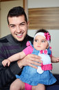 Young man hugging cute baby girl smiling men playing with Royalty Free Stock Photo