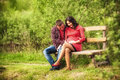 Young man hugging his pregnant happy wife men outdoor Stock Photography