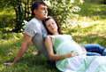A young man hugging his pregnant happy wife outdoor men Stock Photo