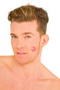 Young man with the imprint of a kiss on the face Royalty Free Stock Image