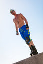 Young man with inline skates in summer outdoor rollerblades skater Royalty Free Stock Image