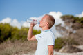 Young man ist drinking water summertime dune beach sky Stock Image