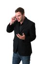 Young Man in jacket talking on the phone Royalty Free Stock Images