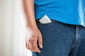 Young man in jeans with condom in pocket Royalty Free Stock Photo