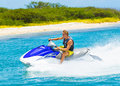 Young man on jet ski tropical ocean vacation concept Royalty Free Stock Photo