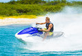 Young man on jet ski tropical ocean vacation concept Royalty Free Stock Photography