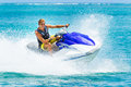 Young man on jet ski tropical ocean vacation concept Stock Images