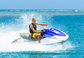 Young man on jet ski tropical ocean vacation concept Royalty Free Stock Images