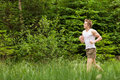 Young man jogging in nature Royalty Free Stock Photo