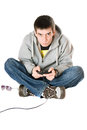 Young man with a joystick for game console. Isolated