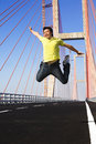 Young man jump very high in bridge area Royalty Free Stock Photo