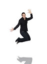 Young man jumping in joy over white background Stock Photography