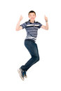 Young man jumping with raised thumbs up isolated on white background Royalty Free Stock Photography