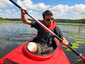 Young man on kayak kayaking a waterway in mueritz nationalpark mecklenburg lake district germany Royalty Free Stock Photos