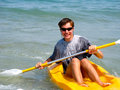 Young man kayaking Stock Photos