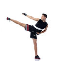Young man kicking practicing body combat Royalty Free Stock Image
