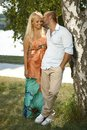 Young man kissing happy casual woman outdoors caucasian men standing women smiling full size Royalty Free Stock Photos