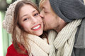Young man kissing his girlfriend Royalty Free Stock Photo