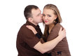 Young man kissing his smiling girlfriend loving couple embracing and men on white background Royalty Free Stock Images