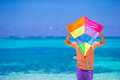 Young man with a kite on a background of turquoise Royalty Free Stock Photo