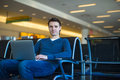 Young man with a laptop at the airport while waiting his flight Royalty Free Stock Images